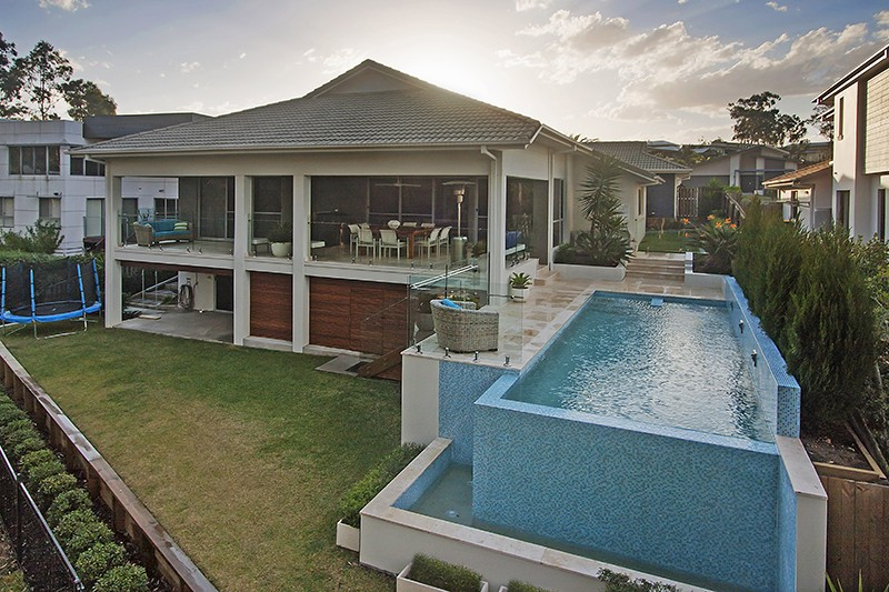 Concrete swimming pool builder brookwater performance pools for Concrete pool builders